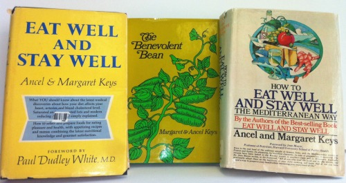 The covers of the three cookbooks written by Ancel and Margaret Keys. Photograph of the collage by JL Dixon. The cover images were used by permission of Penguin Random House LLC (which Doubleday & Company, Inc. is now part of) and Farrar, Straus and Giroux, LLC (which published The Benevolent Bean in 1972).